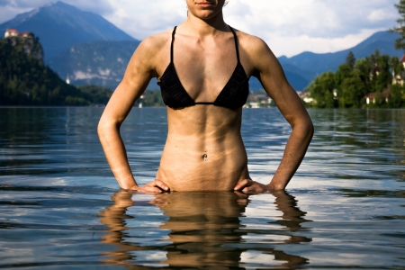 Woman in bikini relaxing in Lake Bled, Slovenia photo