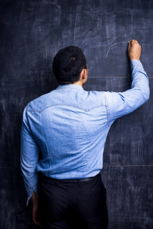 Man drawing on blackboard Stock Photo - 21192770