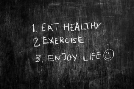 Healthy advice written on blackboard