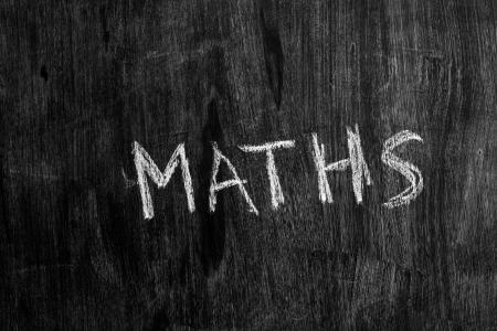 sixth form: The word maths written on blackboard Stock Photo