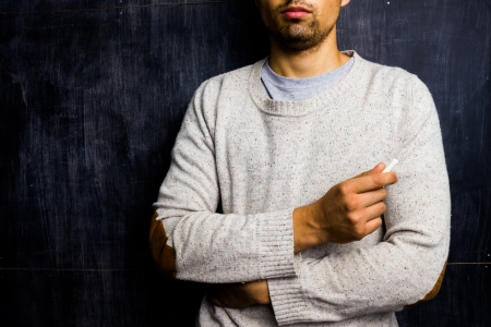 sixth form: Teacher standing inf ront of blackboard Stock Photo