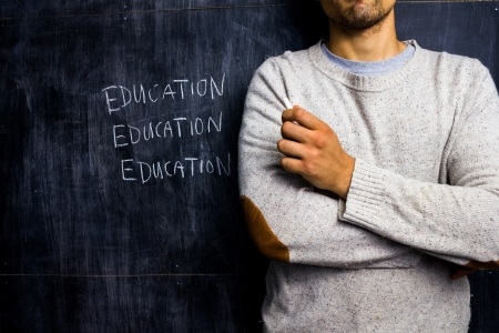 unrecognisable people: Teacher standing inf ront of blackboard Stock Photo