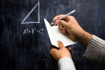 Taking note of Pythagorean theorem on blackboard photo
