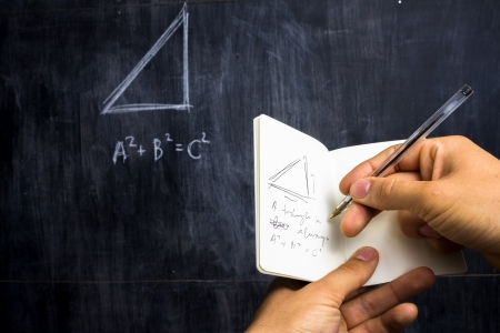 Taking note of Pythagorean theorem on blackboard photo