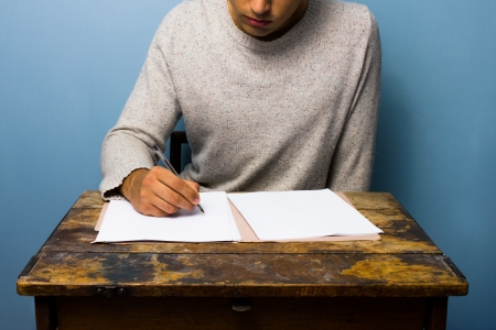Man writing at old desk Stock Photo - 21561809