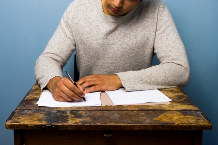 Man writing at old desk Stock Photo - 21561813