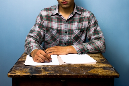Man writing at old desk Stock Photo - 21561815