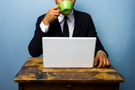 Businessman drinking coffee and working photo
