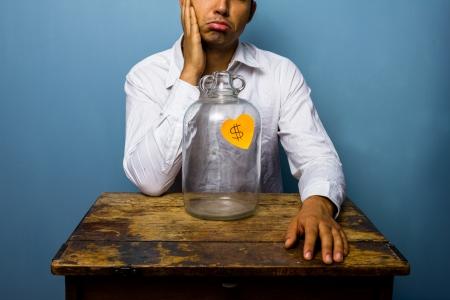 Depressed man has spent all his money Stock Photo