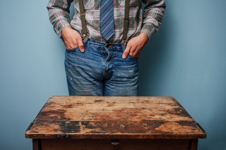 nonchalant: Young man with his hands in his pockets Stock Photo