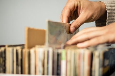 discs: Male hands browsing record shop