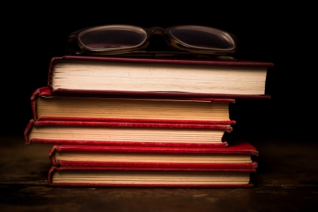 Books and glasses on wood surface photo