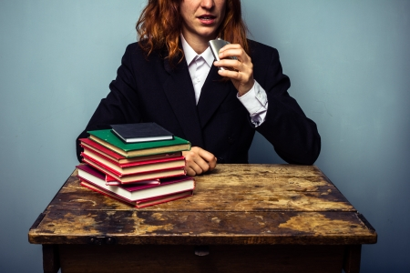 hip flask: Alcoholic business woman drnking from hip flask Stock Photo