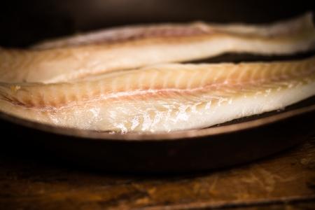 haddock: Two haddock fillets in frying pan