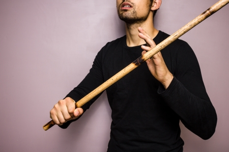 unrecognisable people: Young man practising eskrima stick fighting