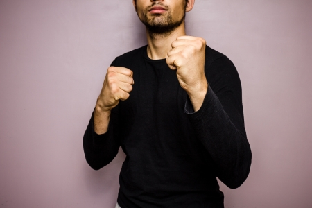 unrecognisable person: Young man in a boxer s stance Stock Photo