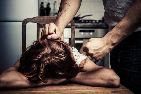 Young woman is being abused by her partner photo