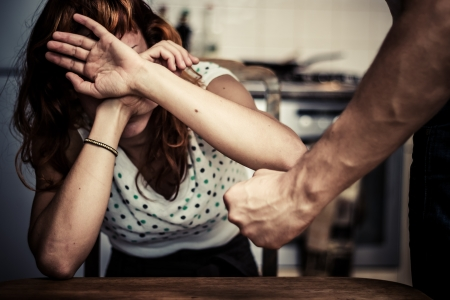 defenceless: Young woman is a victim of domestic abuse Stock Photo