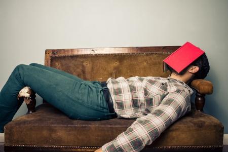 Young man on sofa is sleeping photo