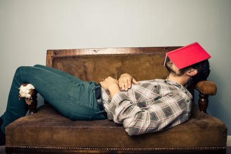 YOung man is sleeping on sofa photo
