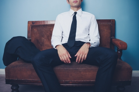 Young businessman is relaxing on a vintage sofa after work Stock Photo - 21994720