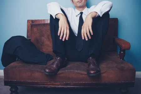 Young businessman is relaxing on a vintage sofa after work Stock Photo - 21994722