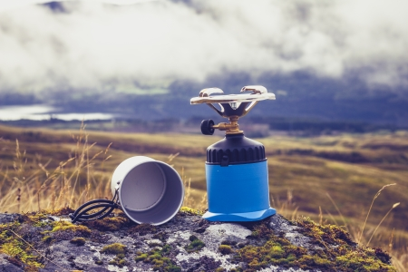 CAmping stove with pot in the mountains photo