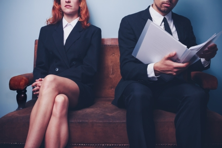 Businesswoman and businessman wating on sofa