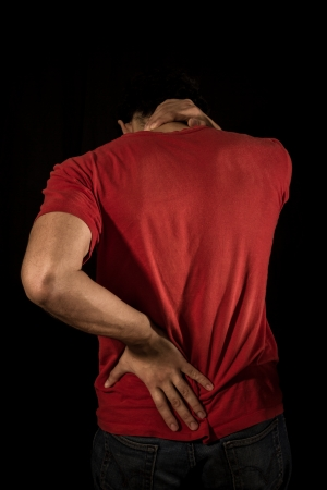 Young man with neck pain and sciatica photo