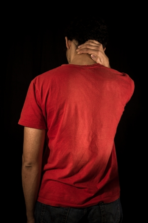 Young man with neck pain photo