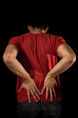 Young man with lower back pain and sciatica photo