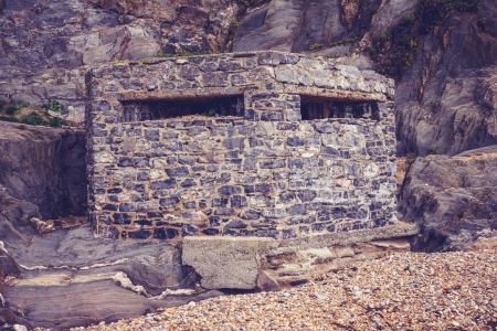 Old world war two bunker on the beach Stock Photo - 23527091