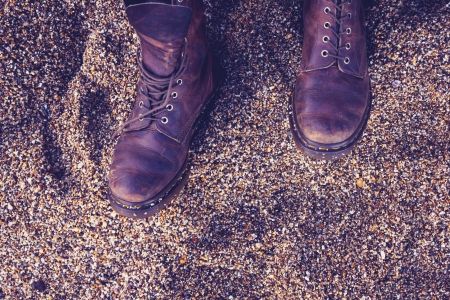 Pair of boots on the beach photo