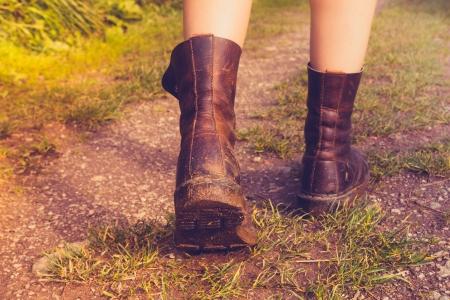 Young woman hiking through muddy terrain photo