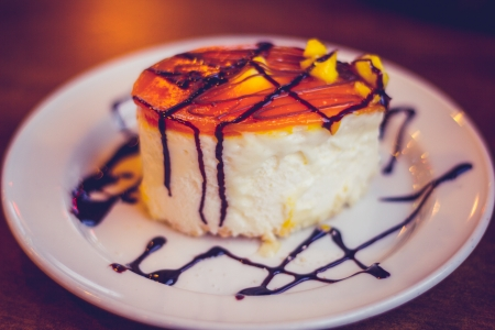 Gluten free cheesecake with chocolate sauce photo