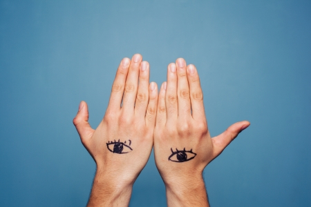 third eye: Third eye painted on man s hands Stock Photo
