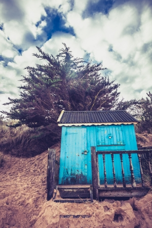 Colorful beach hut against a dramatic sky photo
