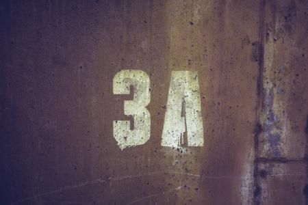 3A stencil on concrete wall photo