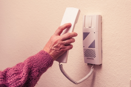 Old woman answering the intercom