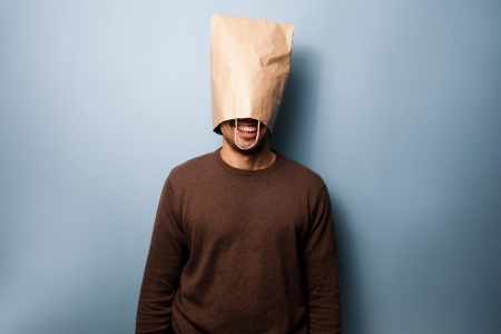 Man with bag over his head is smiling photo