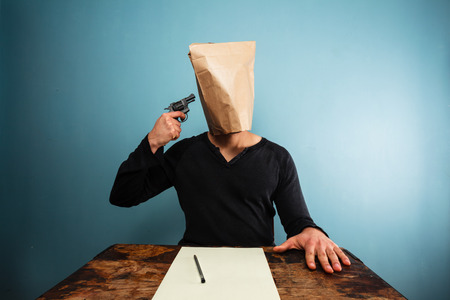Man with paper bag over his head committing suicide  photo