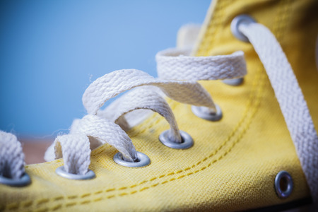 Close up on a yellow shoe and laces photo