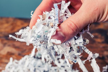 shredding: Hand is holding a bunch of shredded paper Stock Photo
