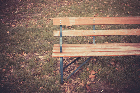 A park bench on an autumns day photo