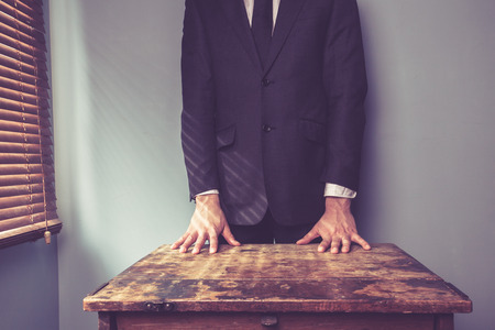 Businessman is standing behind a desk by the window Stock Photo - 27202206