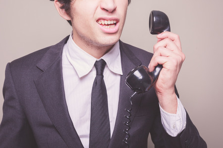 Young businessman cant believe what he is hearing on the phone photo