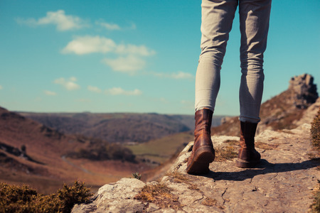 Closeup on a young womans feet as she is trekking in wild