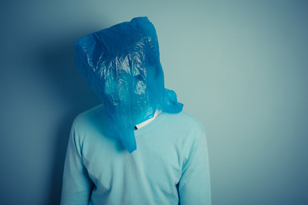 A man is wearing a plastic bag over his head photo