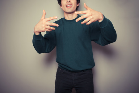 street wise: A Young man thinks he is cool and is making urban gestures with his hands