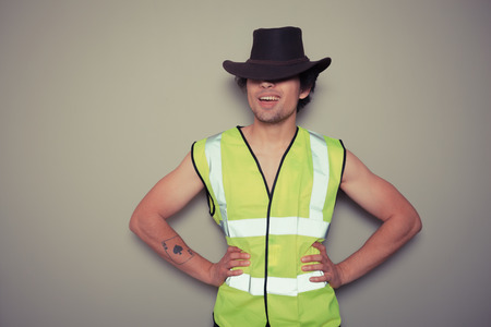 untrustworthy: A cheeky cowboy builder is wearing a high visibility vest